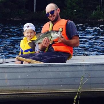 boy and dad fishing