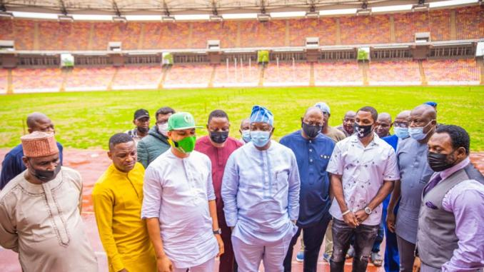 Pictures: Ex-Super Eagles star, Odion Ighalo, now Ambassador, inspects ongoing Moshood Abiola stadium pitch renovation with Minister Dare