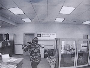 BB&T Bank Robbery Suspect Shown on Surveillance Tape with Weapon -- Photo Courtesy: NCSD