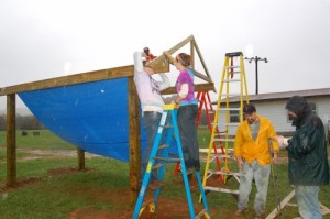 Volunteers from APO work on that will be a covered picnic area at RVCC.