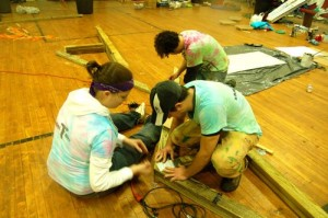 APO members assemble trusses that will be used in the roof of the outdoor pavilion.