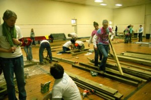 Inside, in the gym, crews were busy assembling pieces that would be installed outside.
