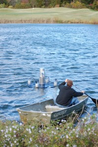 To get the fountain platform out in the pond it had to be pushed in front of a small boat fighting 40 mile per hour winds.