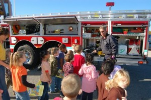 Stuart Smith of Wintergreen Fire Department shows students some of the gear on used their ladder truck.