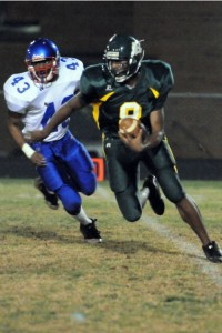 Photos By Paul Purpura : NCHS Senior, Mark Wells, Jr runs with the ball at Friday's Game against Dan River