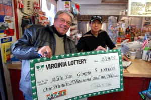 ©2009 NCL Magazine : Alain San Giorgio (left) shows off his $100,000.00 check with Se. Myomg Lim at Graves Grocery just south of Nellysford, Virginia.