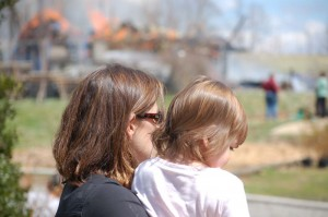 ©2009 NCL Magazine : Photo By Tommy Stafford : Close friend and co-owner of Blue Mountain Brewery, Mandi Smack, holds Olivia Harris while her parents Ken and Yvonne deal with Sunday's fire.