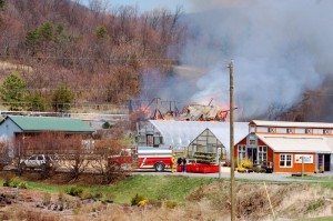The historic barn on fire as viewed from Route 151 just minutes after fire crews arrived on the scene.