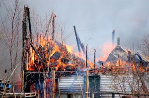 The picture says it all. The second floor and loft of the barn collapses as the fire burns.