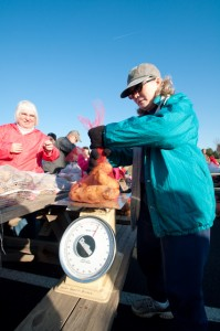Angie Sims weighs a small part of the 40,000 pounds bagged this weekend.