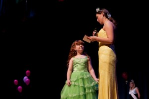 Lacy Viar, Miss Nelson 2008, asks questions of one of the contestants.