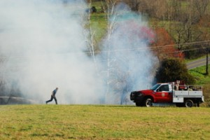 Photos By Ann Strober : ©2009 NCL Magazine : A fireman runs back toward his truck during Thursday afternoon's brush fire in the vicinity of Tuckahoe Antique Mall north of Nellysford, Virginia