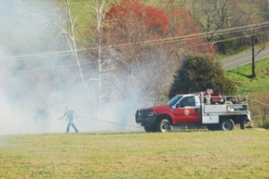Thick smoke rises from the fire Thursday afternoon.