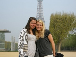 Mallory Crandall (left) poses with friend Martina Cook in front of the Eiffel Tower in Paris, France.