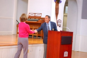 ©2009 NCL Magazine : Andrew Hodson (right) co-chair of NCCF,  hands Peggy Whitehead, Executive Director of Blue Ridge Medical Center,  one of the many grants awarded at Tuesday afternoon's ceremony.