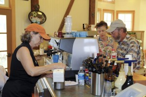 Photos By Paul Purpura : ©2009 NCL Magazine : Nancy Kern (left) co-owner of the new Java Depot in Roseland/Beech Grove whips up a coffee at this past Friday's soft opening of the coffee house and restaurant.