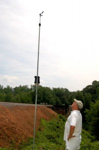 Kevin inspects his wind vane and anemometer on his Rockfish Weather Station.
