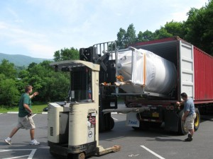 ©2009 NCL Magazine : Photo By BMB : Taylor Smack, co-owner, of Blue Mountain Brewery in Afton, supervises the offloading of a new brewing tank at their operation.