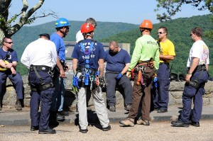 Area rescue squad members prepare to repel the rock faces along the BRP.