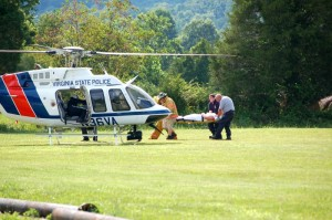 Crews from Wintergreen & Rockfish Fire and Rescue prepare to load one of the patients into a VA State Police Helicopter Sunday afternoon at RVCC.