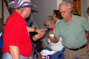 Photos By Yvette Stafford : ©2009 www.nelsoncountylife.com : Democracy Vineyards co-founder, Jim Turpin, pours up one of his white wines at Friday night's debut inside The Lovingston Opry.