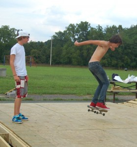 Jacob Lane looks on as Colin Bruguiere of Afton tries out the Sk8 Nelson Skate Park that officially opens Saturday morning @ 10 AM!