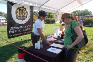 Heidi Crandall of Devils Backbone Brewing Company talks about one of their award winning beers with folks dropping by.