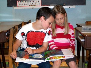 Photo courtesy of NBS : ©2009 www.nelsoncountylife.com : Zachary Gardiner and Elena are two of 70 students at North Branch School who read The Very Hungry Caterpillar as part of the national program Read for the Record.