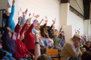 ©2008-2009 www.nelsoncountylife.com : Students at Rockfish River Elementary wave American flags in honor of veterans at the 2008 Veterans Day Program in Afton, Virgina