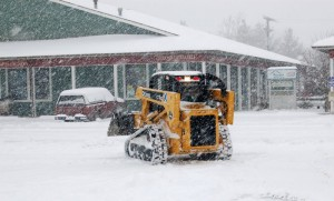 A driver works to clear the lot at Valley Green Center in Nellysford.