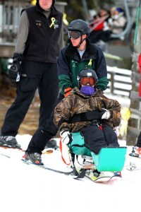 A solider at this past weekend's event takes to the slops in a specially modified ski rig.