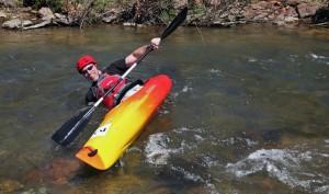 John Fritschi, of Hampton flips his kayak at the start of the paddling portion of the Piney River Mini Triathlon.