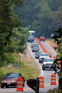 ©2010 www.nelsoncountylife.com : Cars narrow to one lane on 151 in Greenfield passing a sign (lower left) marking the spot where 48 year old Laura Cavedo and her two daughters were killed in August of 2007.