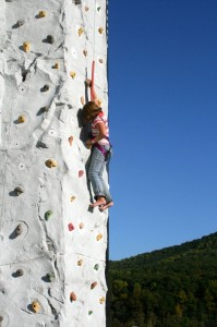 In addition to music, this youngster took a stab at the rock climbing wall.