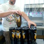 Brian Goff filling bottles of beer. Photo by Tommy Stafford.
