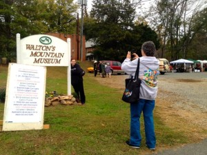 Fans pose for a camera shot in from of the museum's sign out front during the 21st anniversary celebration.