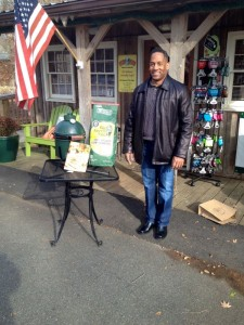 Clinton Hudson of Cinncinatti, Ohio standing beside the Big Green Egg he won in a raffle at Zestivities in the Wild Wolf Shopping Plaza in Nellysford, VA - Saturday - November 30, 2013.