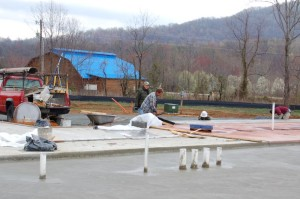 DB owner & founder Steve Crandall inspects work on the foundation of what will eventually become the Devils Backbone Brewing Basecamp located in Nelson County, VA. The was April 2008, months before the November opening.