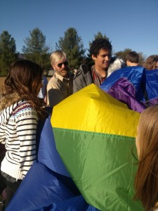 Caroline Lancaster, Scott Cohrs, Kahlil Banning,and other students wrestle the balloon back into its pack.