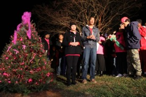 ©™2013 Blue Ridge Life : Photos By BRL Photographer Shay Munroe : Alexis Murphy's family sings Silent Night this past Tuesday evening - December 3, 2013 - as part of a Christmas tree lighting ceremony held in Lovingston, Virginia at the Liberty Gas Station where where was last seen on August 3, 2013.