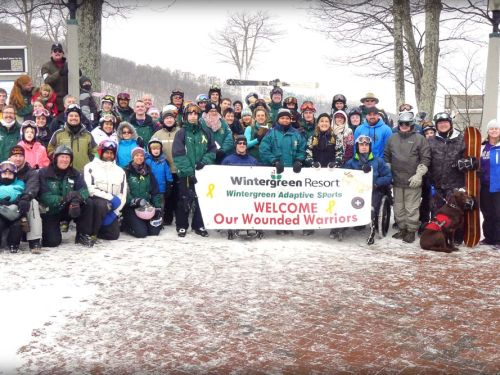 ©™2014 Blue Ridge Life : Photos By BRL Mountain Photographer Paul Purpura : Wounded Warriors pose for their annual group shot during the 10th Annual Wounded Warriors Weekend held January 24 & 25th 2014 at Wintergreen Resort.