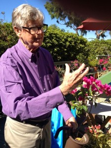 Earl Hamner checks on one of his many Bonsai plants in his outdoor garden at his home in Studio City, California.