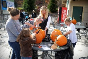 ©2014 Blue Ridge Life : Photo by Paul Purpura : Moms & kids had a great time carving pumpkins this past weekend at Wintergreen Resort. It was just one of the many activities held during Harvest Fest Weekend I. Harvest Fest Weekend II is being held this coming weekend at Wintergreen.