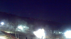 Webcam shot courtesy of Wintergreen Resort. : The Friday night sky is fully lit at Wintergreen Resort as the snowmaking begins.