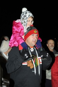 Steve McInich along with his daughter Chloe from Charlottesville, listen to the chorus sing Christmas carols.