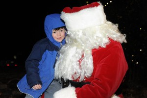 ©2014 Blue Ridge Life Magazine : Photos By BRLM Mountain Photographer Paul Purpura : This youngster was all smiles this past Wednesday night tell Santa all about the wish list during the annual tree lighting, caroling and Santa's visit at Stoney Creek in Nellysford.