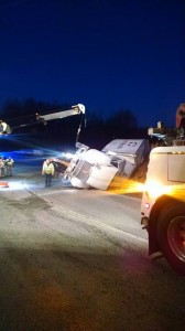 Photo Courtesy of Lovingston Volunteer Fire Department : An overturned tractor trailer at Oak Ridge Road and US 29 in South Nelson County slowed traffic in the northbound lane as crews worked to clean up the mess.