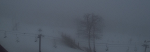 Screen capture via Wintergreen Resort's Web Cam : This shot around noon Wednesday shows the foggy and rainy conditions at Wintergreen Resort - Wednesday - February 24, 2016