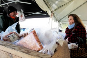 ©2016 Blue Ridge Life Magazine : Photo By BRL Region Photographer Marcie Gates : Christina Riggleman (co-owner of Silverback Distillery in Afton, VA) braves the 30 MPH winds and temps in the 30s this past Saturday at the opening day of the Nelson Farmers Market in Nellysford. Saturday - April 9, 2016