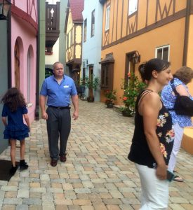 ©2016 Blue Ridge Life Magazine : Photo By Tommy Stafford : Will Fenton (L and owner of The Fenton Inn) strolls down the cobblestone street in the courtyard of his newly opened inn just off of the Blue Ridge Parkway. Wednesday - August 17, 2016